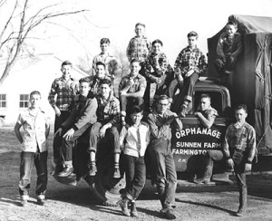 Black and white image of boys by truck representing Presbyterian Children's Homes and Services of Missouri History page