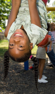 Image of African American girl in playground representing Presbyterian Children's Homes and Services of Missouri Leadership Group page