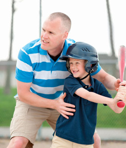 Image of volunteer playing baseball with boy representing Presbyterian Children's Homes and Services of Missouri volunteer opportunities locations